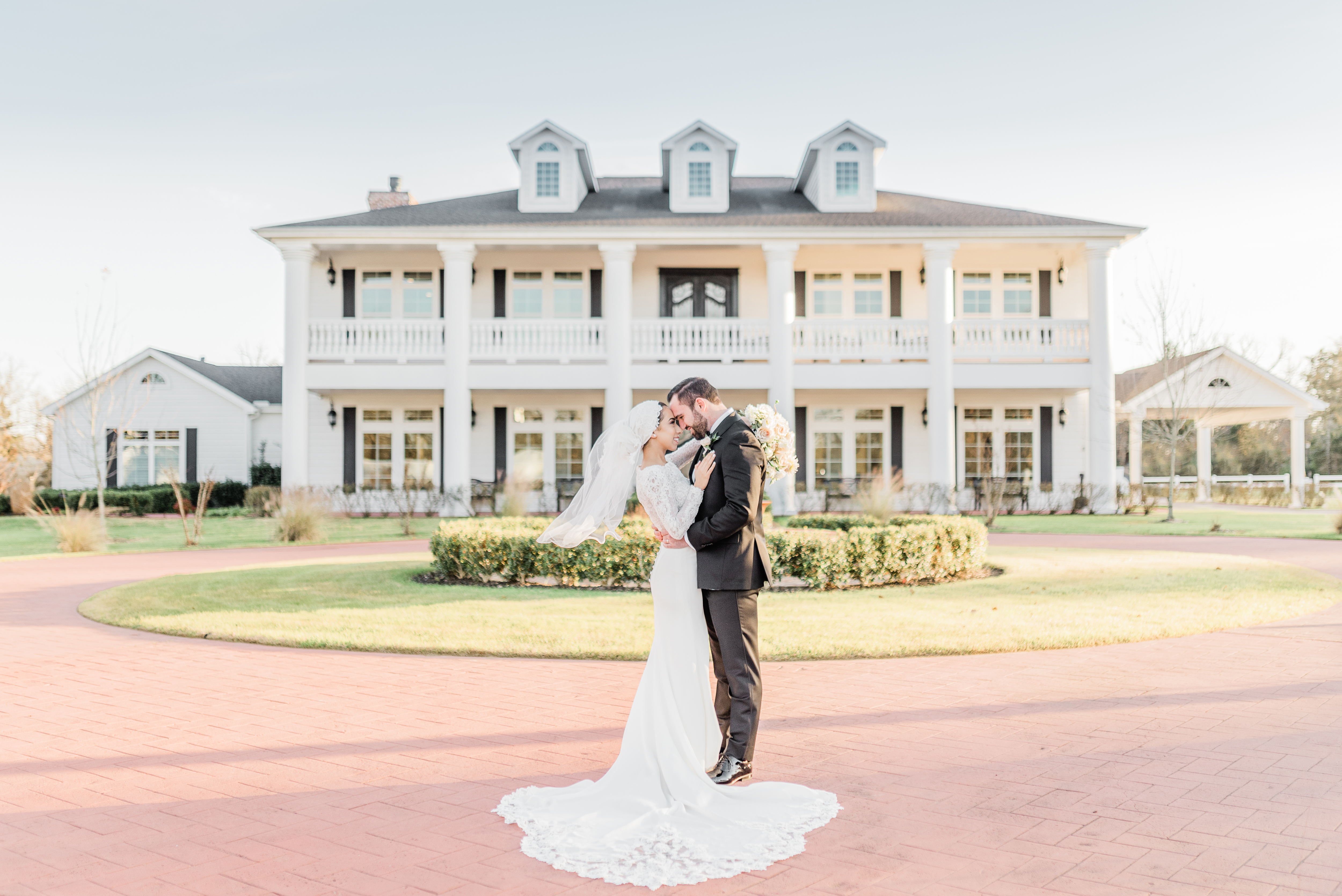 Bride and Groom Portraits Long Train Veil Blush Rose Bouquet | The Springs in Rockwall Texas by DFW Dallas Fort Worth wedding photographer Karina Danielle Photography