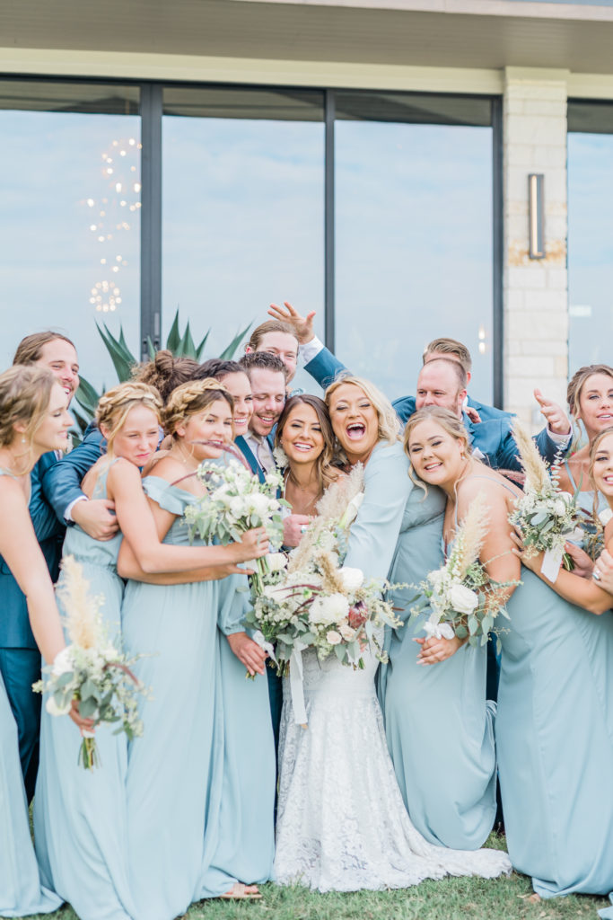 Bride and Groom Bridesmaids Groomsmen Wedding Party Dusty Blue Dresses Pampas Grass Bouquet Navy Suit Boho | Stonehouse Villa in Driftwood TX by DFW Dallas Fort Worth wedding photographer Karina Danielle Photography