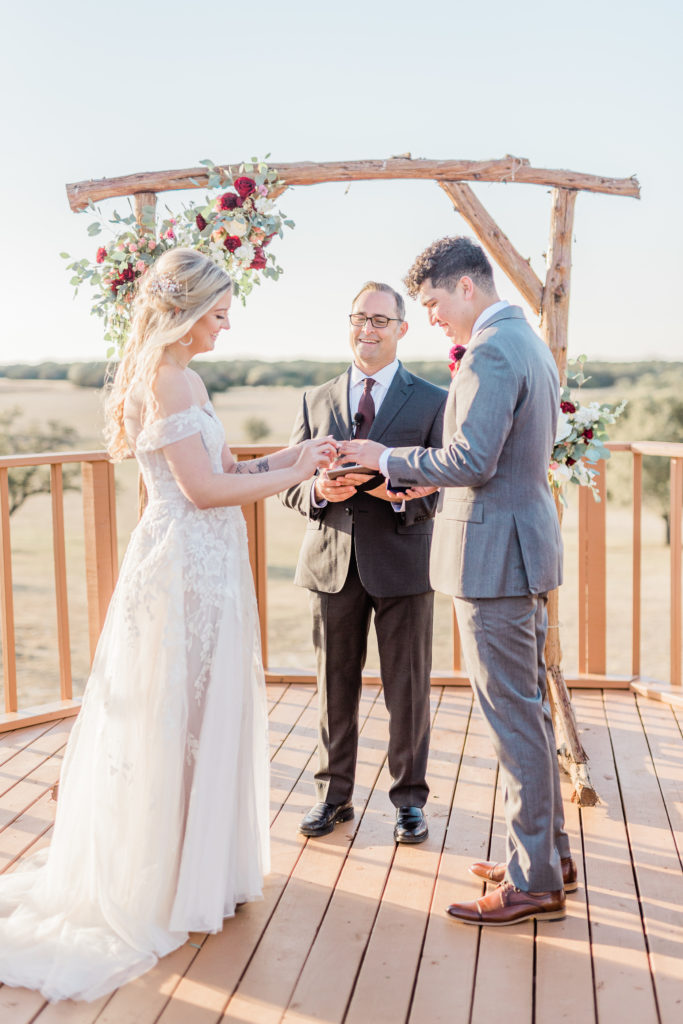 Bride and Groom Ceremony Strapless Dress Grey Suit Velvet Tie Blush and Wine Bouquet Eucalyptus   Wagon Springs Ranch in Burnet TX by DFW Dallas Fort Worth wedding photographer Karina Danielle Photography